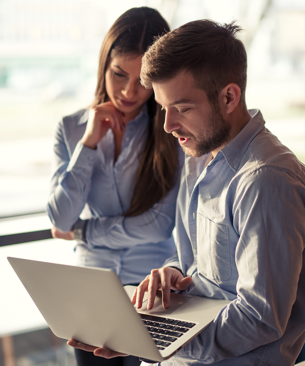 business professionals viewing a laptop